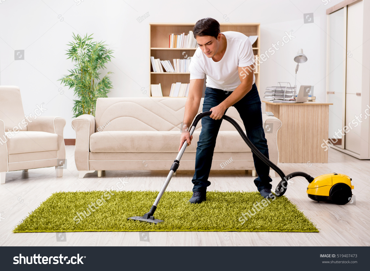 Man cleaning home vacuum cleaner stock photo 519407473 for House cleaning stock photos
