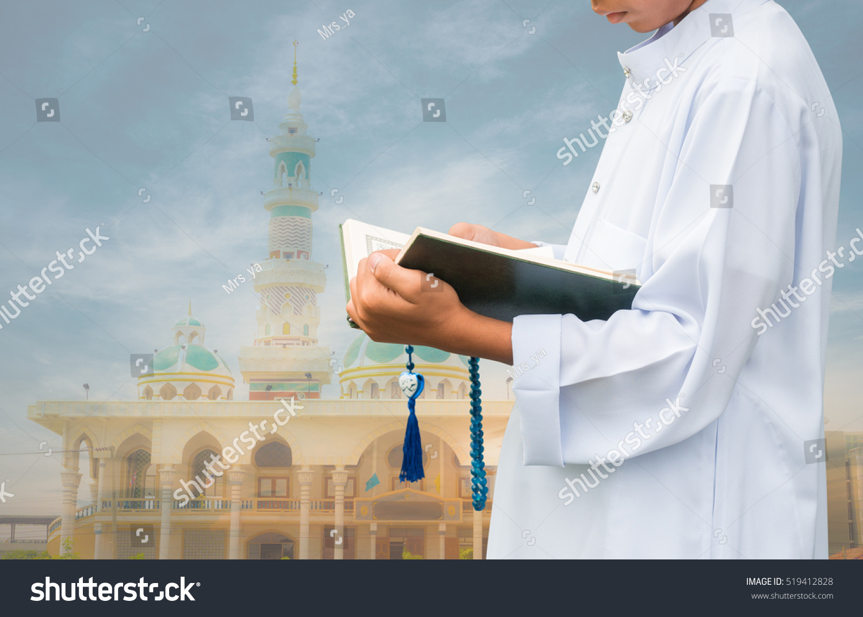 Muslim Child Reading Book On Gradient Stock Photo