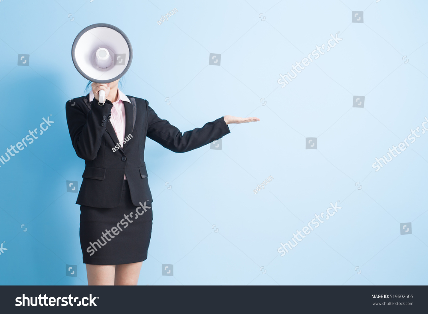 business woman take microphone and show something isolated blue background