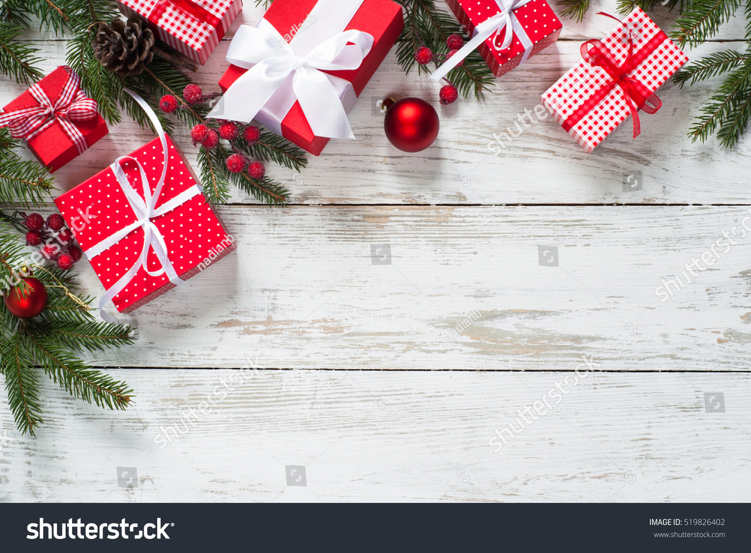 Christmas gift box christmas presents red 519826402 christmas gift box christmas presents in red boxes at white wooden table flat lay negle Image collections