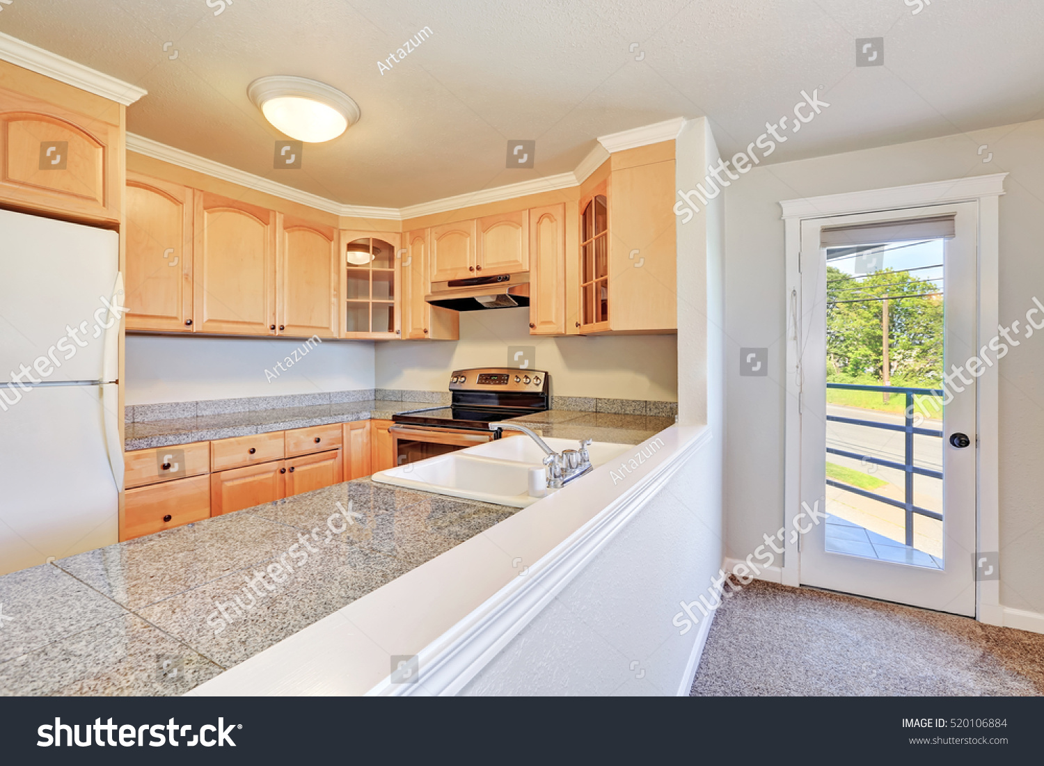 Interior Of Nice U Shaped Kitchen Room With Light Wood Cabinets , Granite  Counter Tops