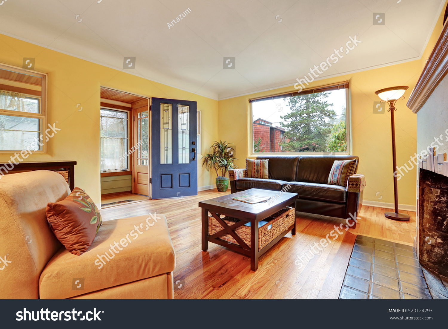 Cozy Living Room With Fireplace. Cozy Living Room Interior With Warm Yellow  Walls , Fireplace