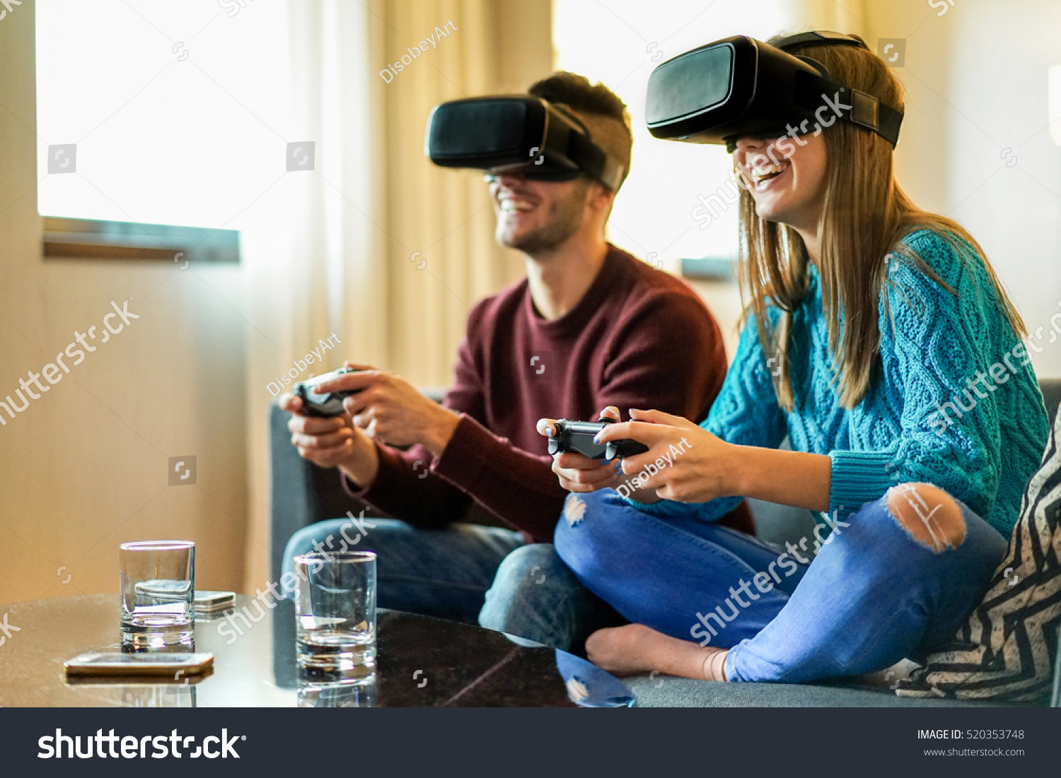 Young happy couple playing video games stock photo for The model apartment play