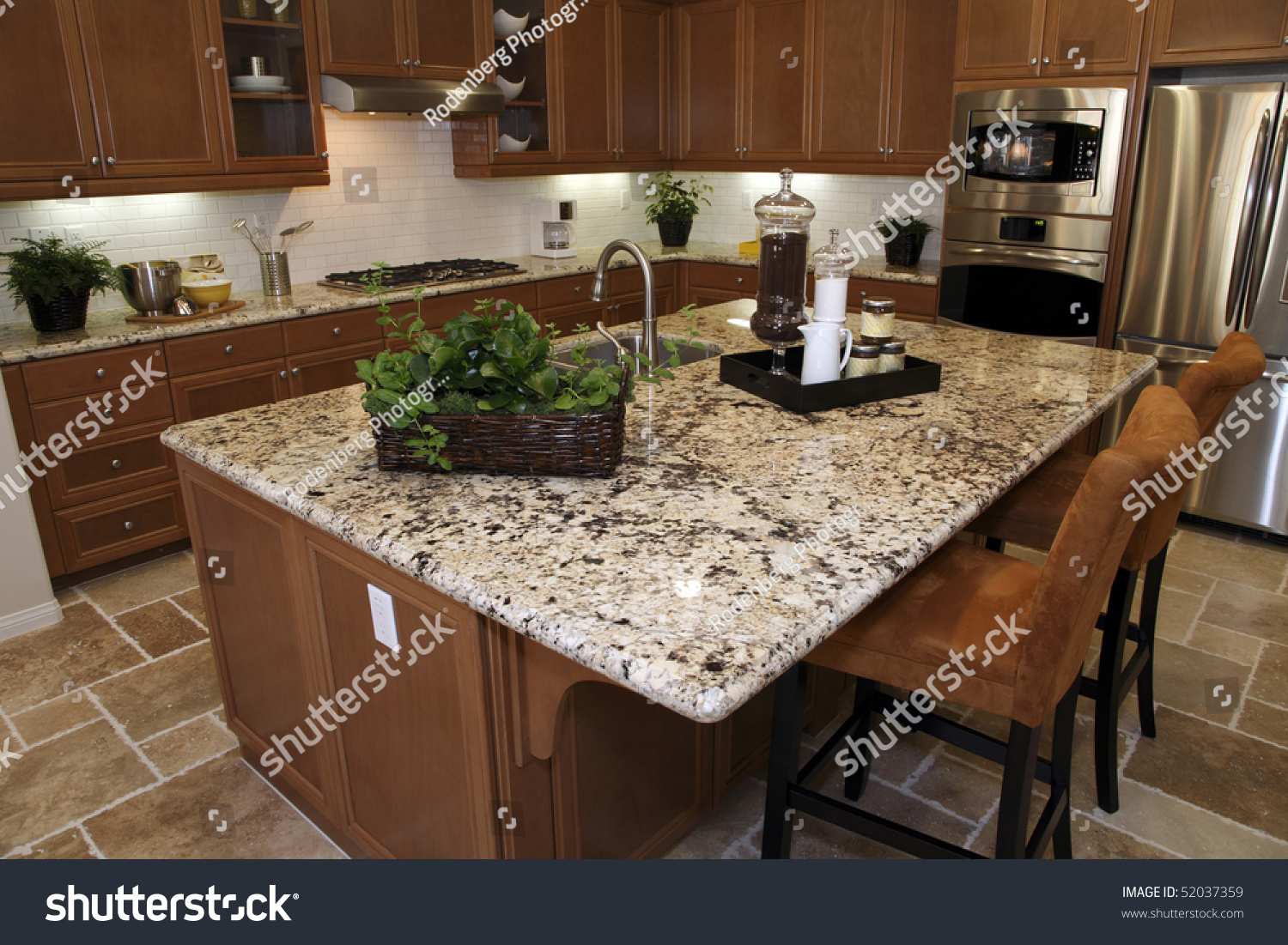 Granite Island Kitchen Kitchen With Stainless Steel Appliances And A Granite Island