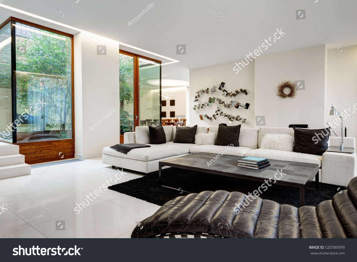 comfortable living room furniture. Large and comfortable living room with a white sofa in luxurious mansion  winter Comfortable Living Room White Sofa Stock Photo 520780999