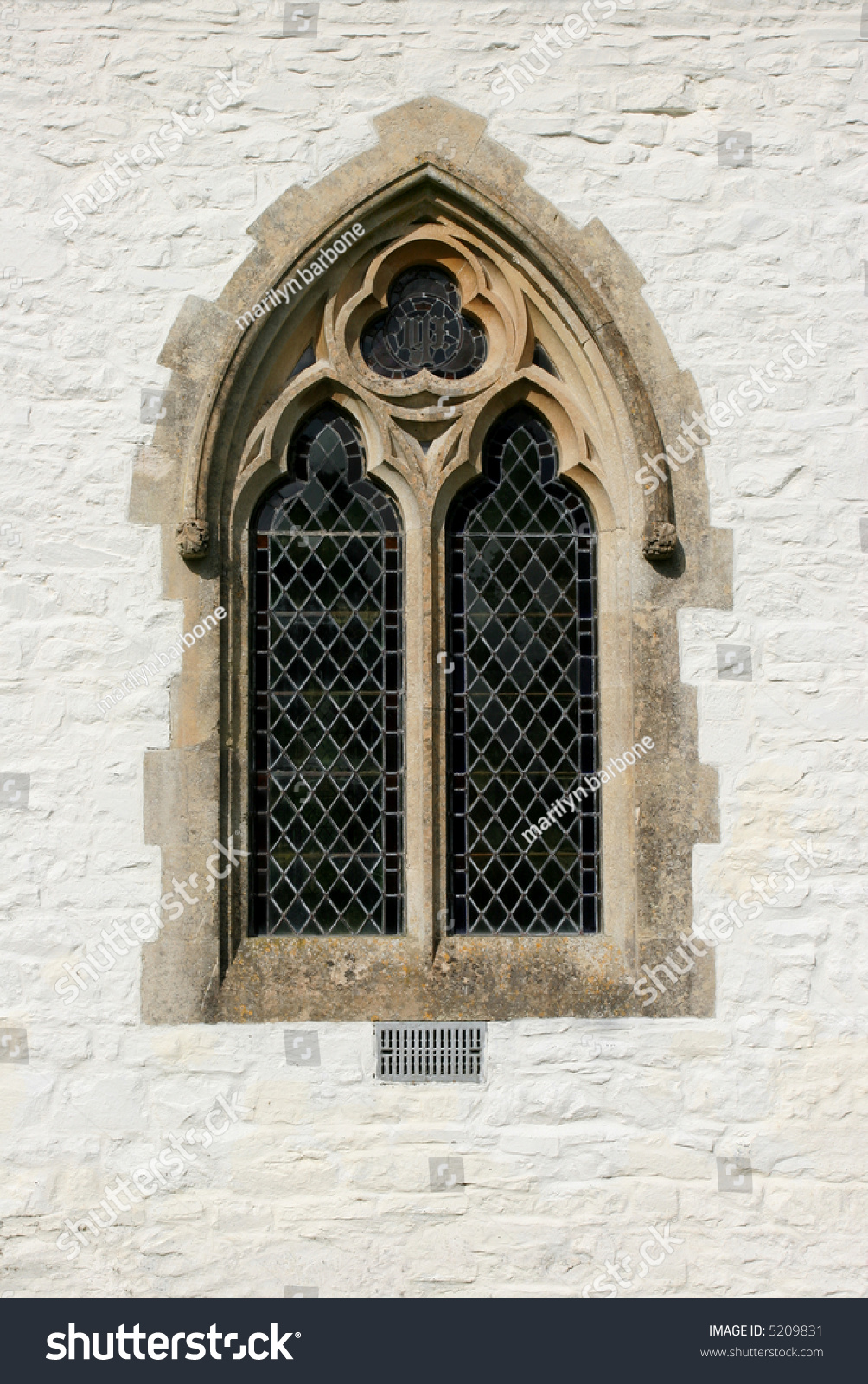 Gothic leaded glass window on outside stock photo 5209831 for Fenetre gothique