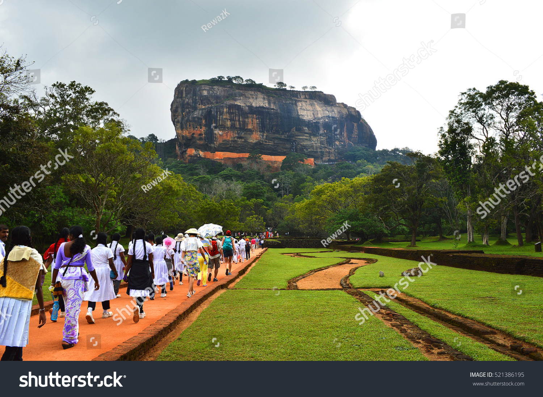 Tourists walk along a trail climbing to Sigiriya