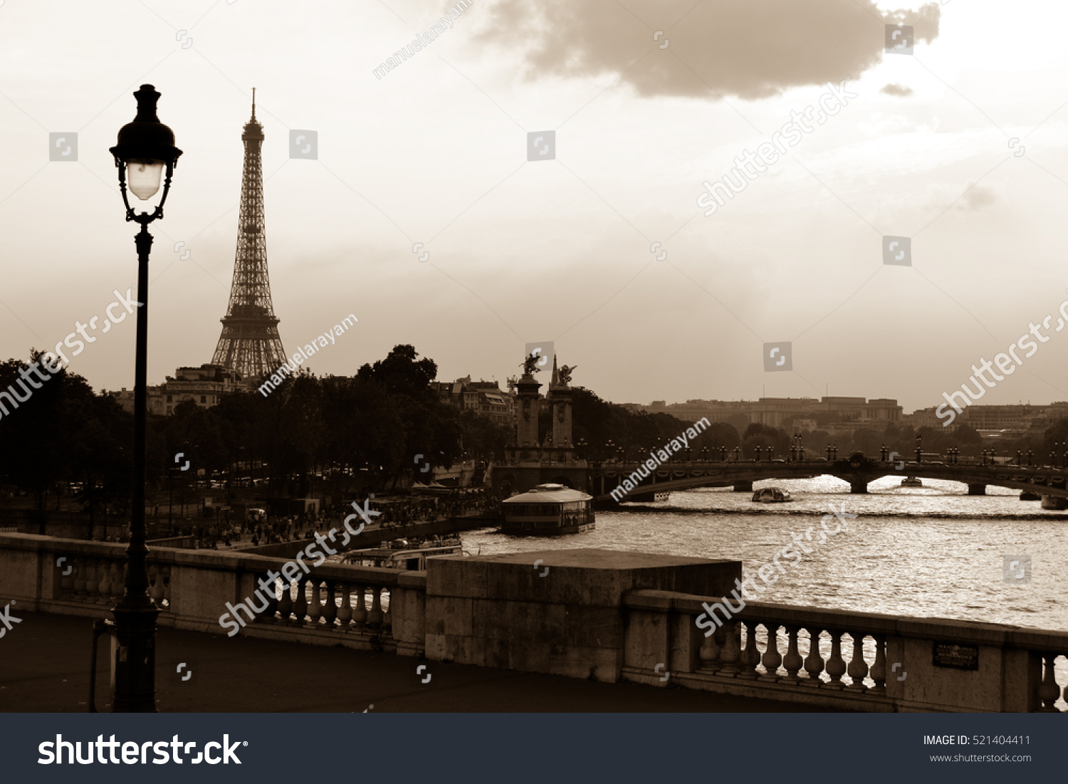 View of Paris and Eiffel Tower from a bridge over the Seine with a sepia filter