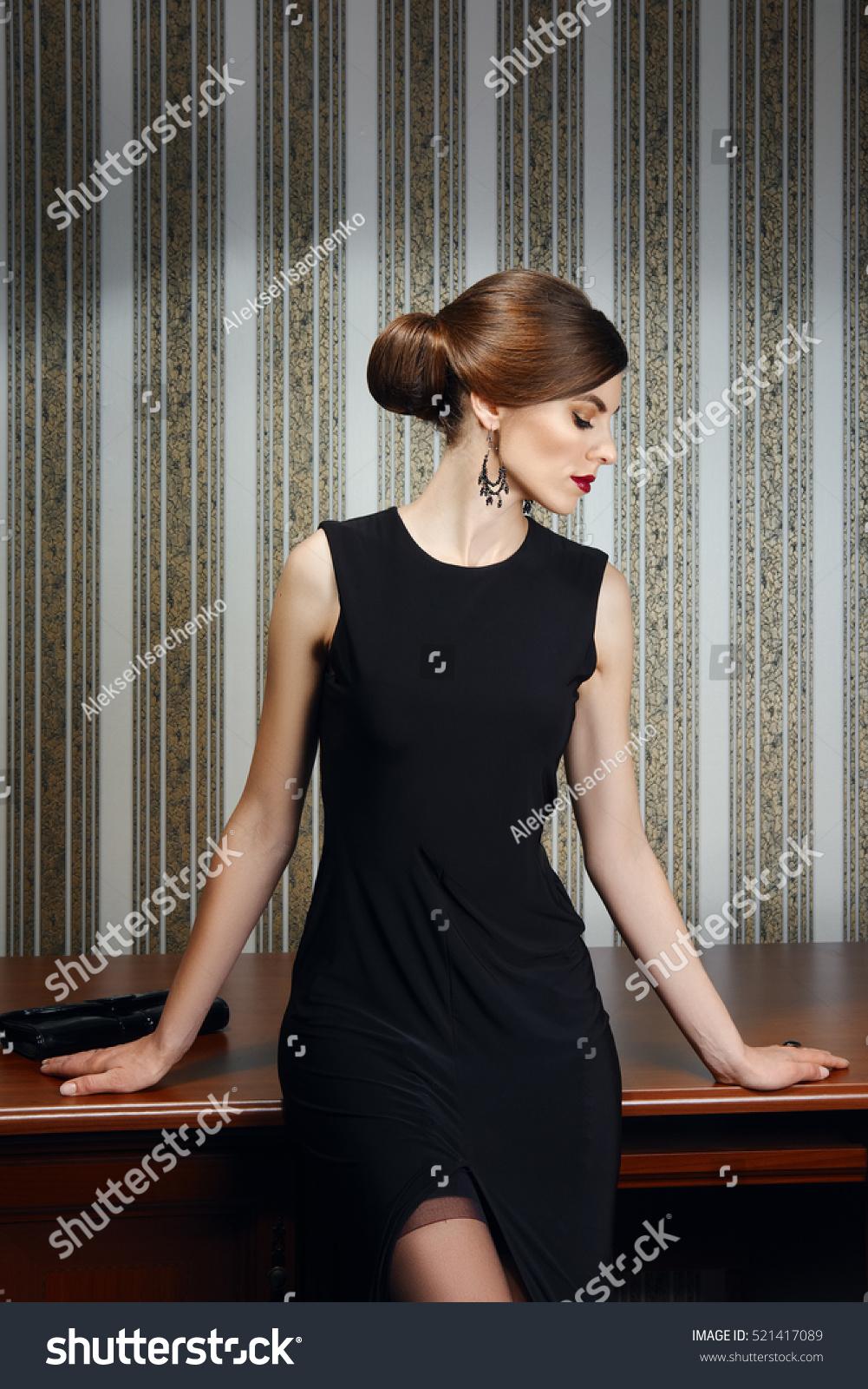 Gorgeous lady elegant evening black dress stock photo 521417089 gorgeous lady in elegant evening black dress with deep cut in stockings girl posing near ombrellifo Gallery