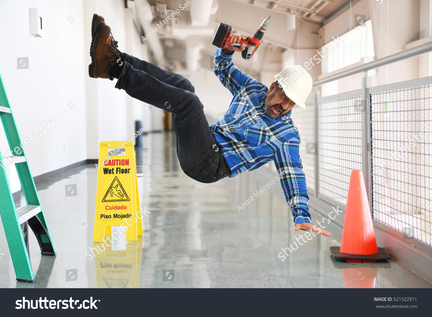 Construction Worker Falling Off Ladder Inside Stock Photo