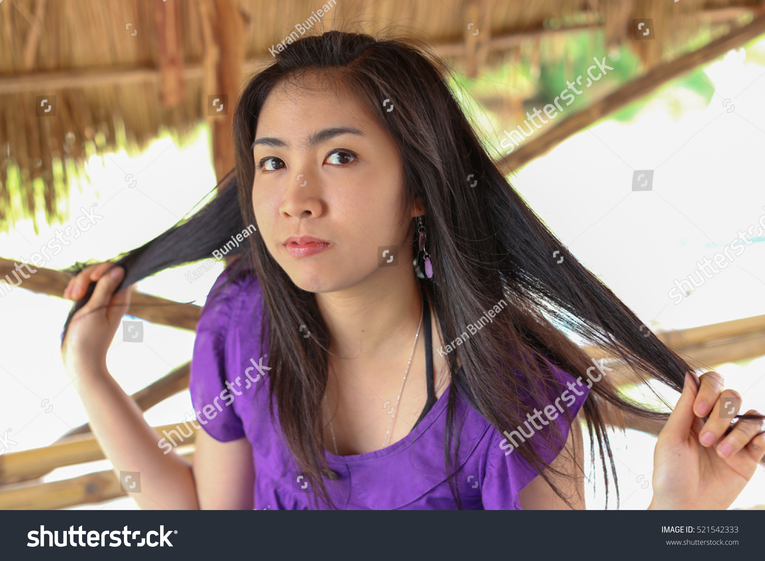 portrait beautiful charming asian girl spreading stock photo (safe