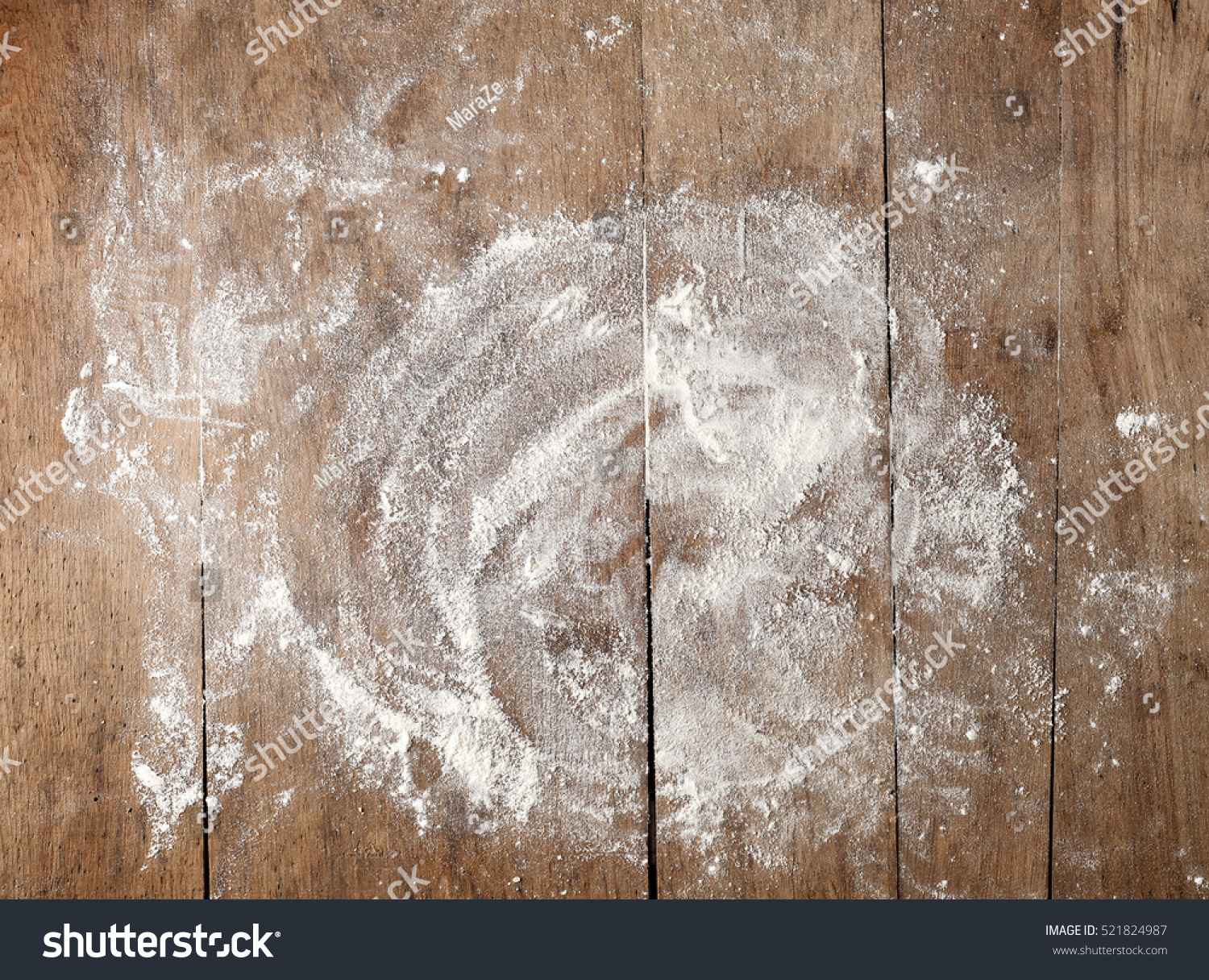 white flour on rustic wooden table top view