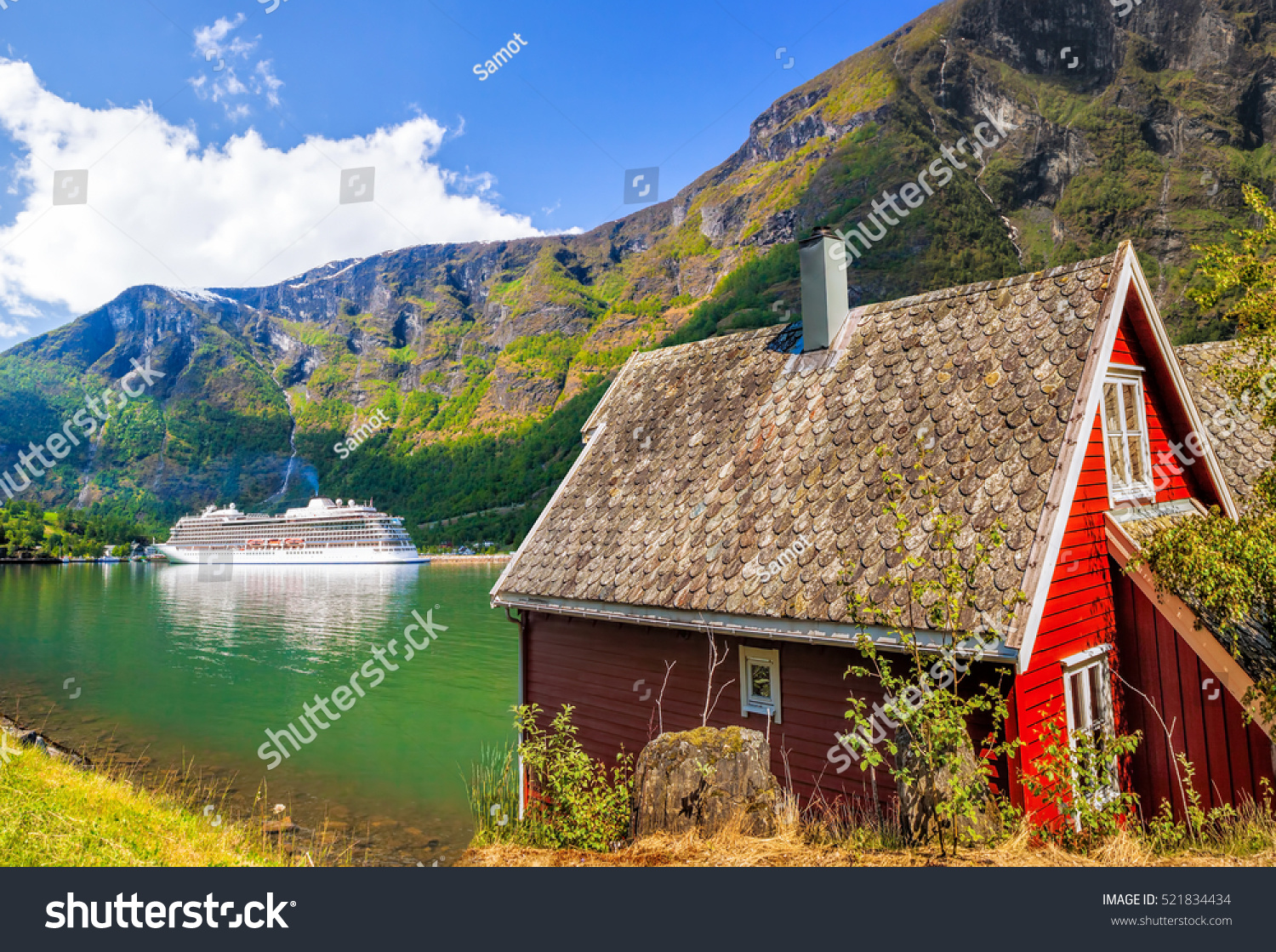 Red cottage against cruise ship fjord stock photo for Red cottage