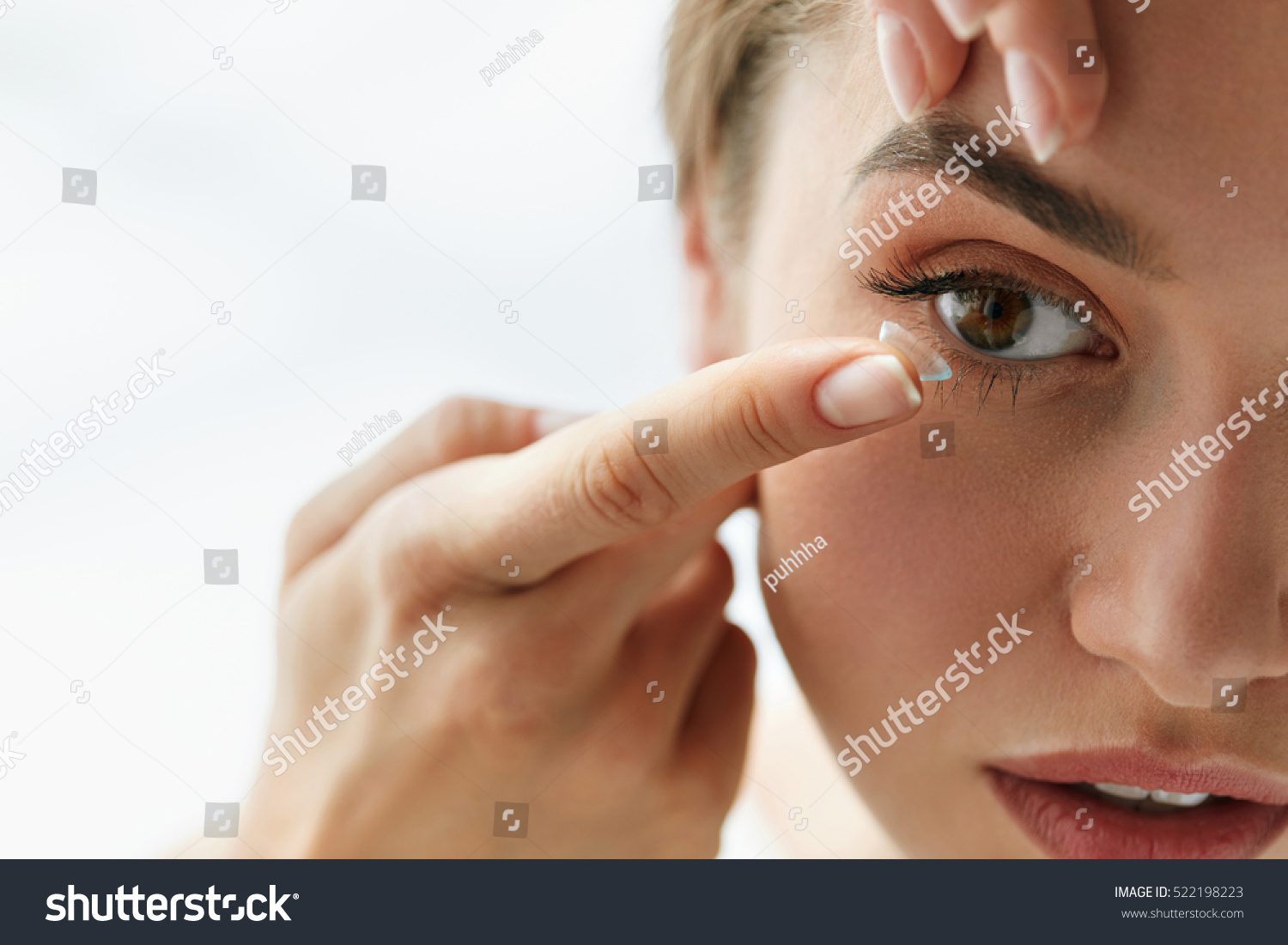 Contact Lens For Vision. Closeup Of Female Face With Applying Contact Lens On Her Brown Eyes. Beautiful Woman Putting Eye Lenses With Hands. Opthalmology Medicine And Health. High Resolution  #522198223