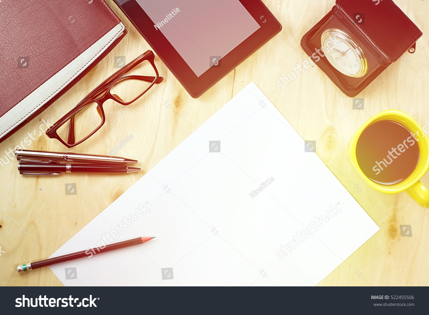 Office table desk top view tablet stock photo 522455506 shutterstock office table desk top view with tablet pca cup of coffee pen geotapseo Image collections