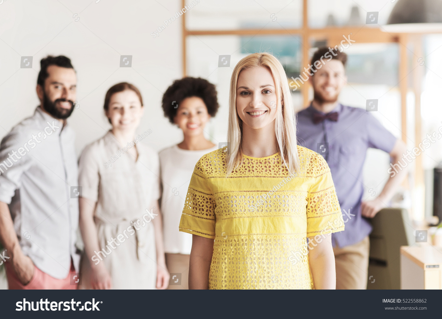 business startup people and teamwork concept happy young woman over creative team in office