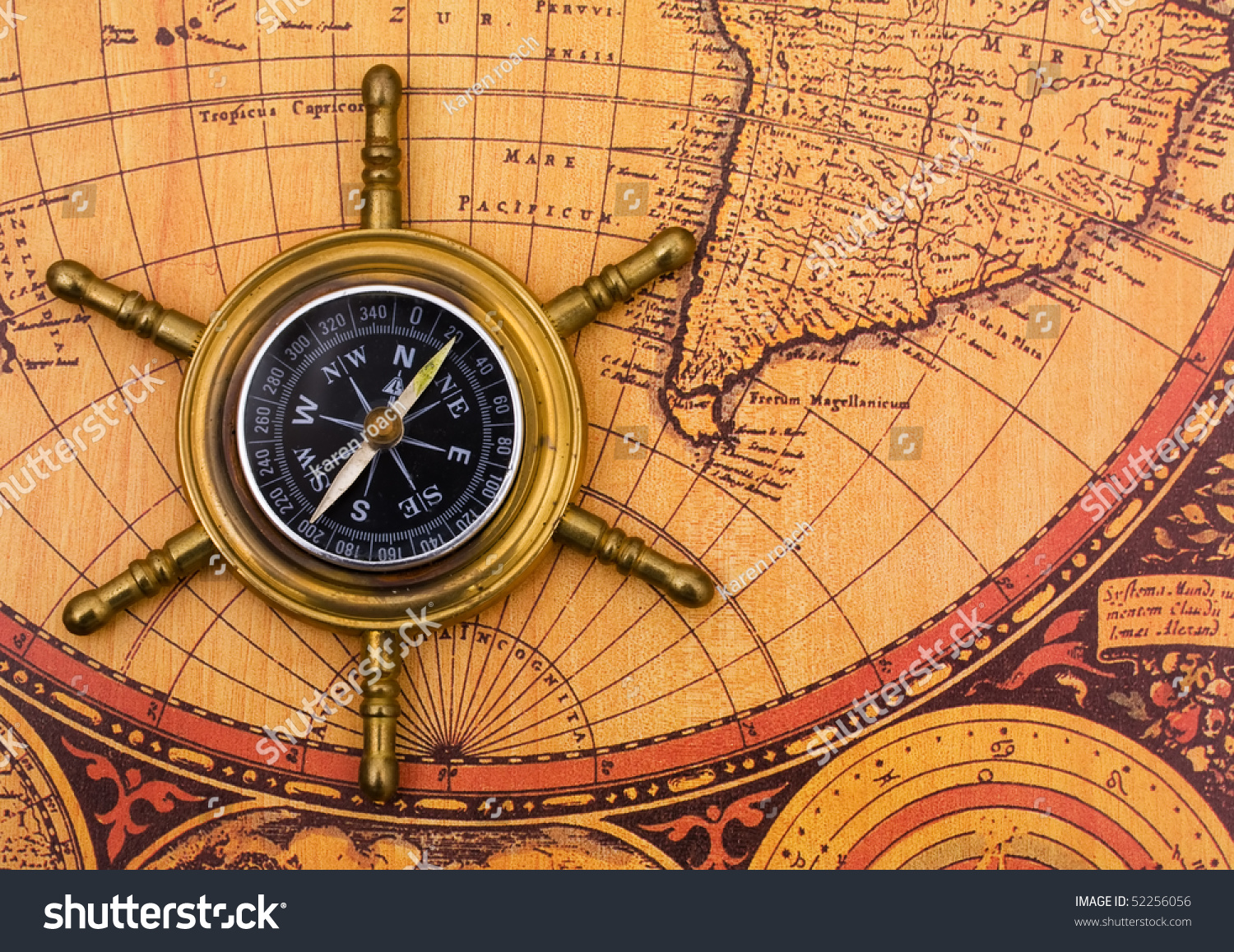 Compass on old world map background stock photo royalty free a compass on a old world map background gumiabroncs Gallery