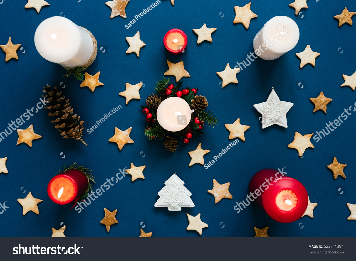 lit candles on christmas themed background stock photo (royalty free