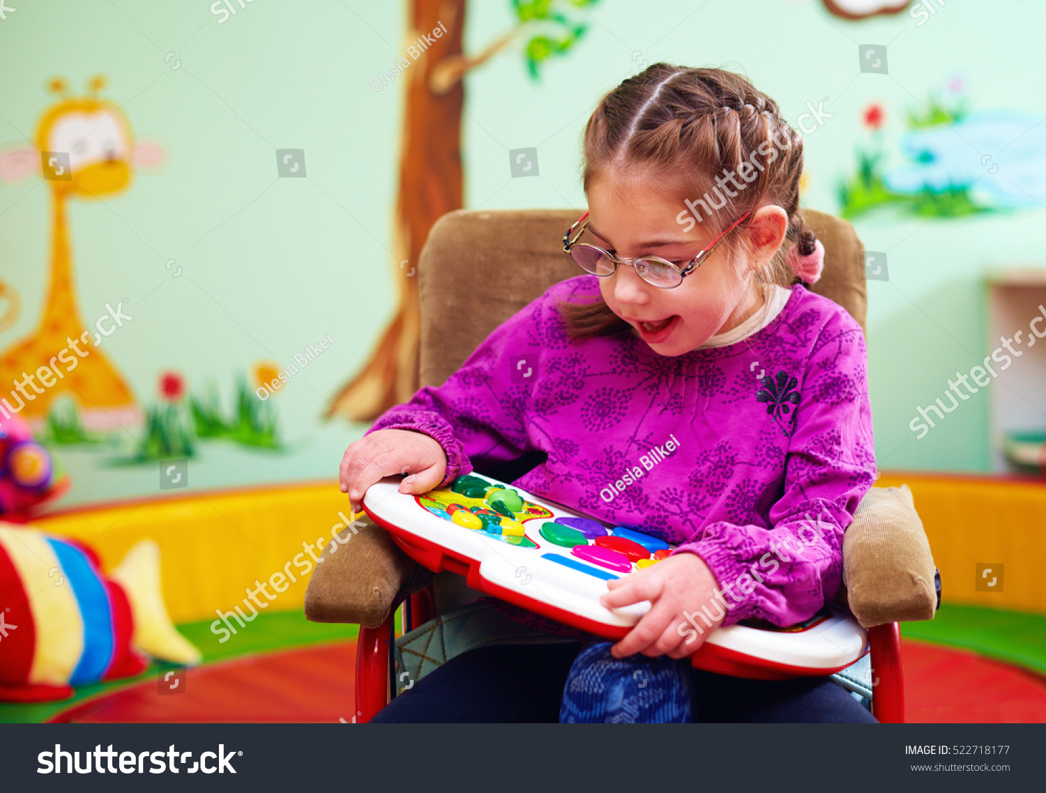 Cute Girl Wheelchair Playing Developing Toy Stock Photo Edit Now