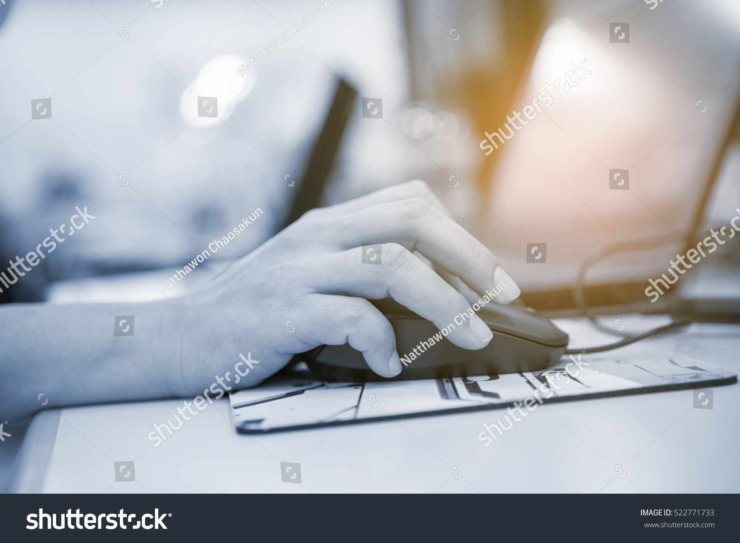 Image of hand clicking computer mouse