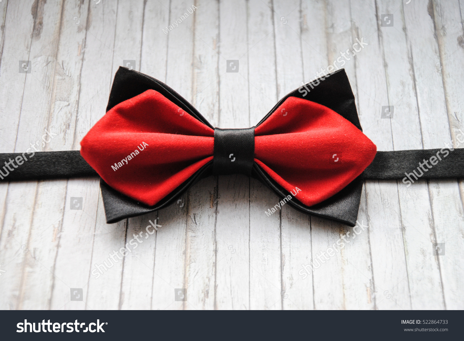 Red Black Bowtie On Wooden Background Stock Photo ...