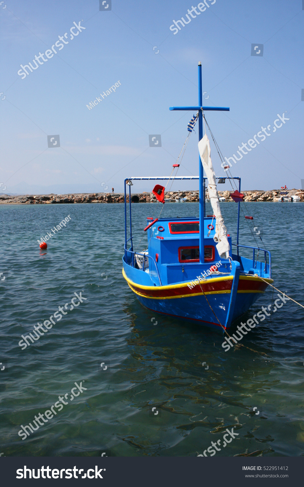 Small colorful fishing boat inboard engine stock photo for Used fishing boat