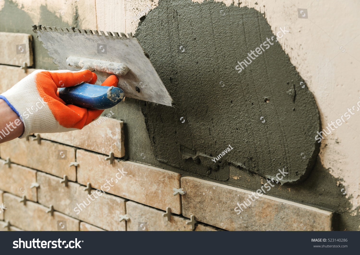 Installing Tiles On Wall Worker Setting Stock Photo (Royalty Free ...