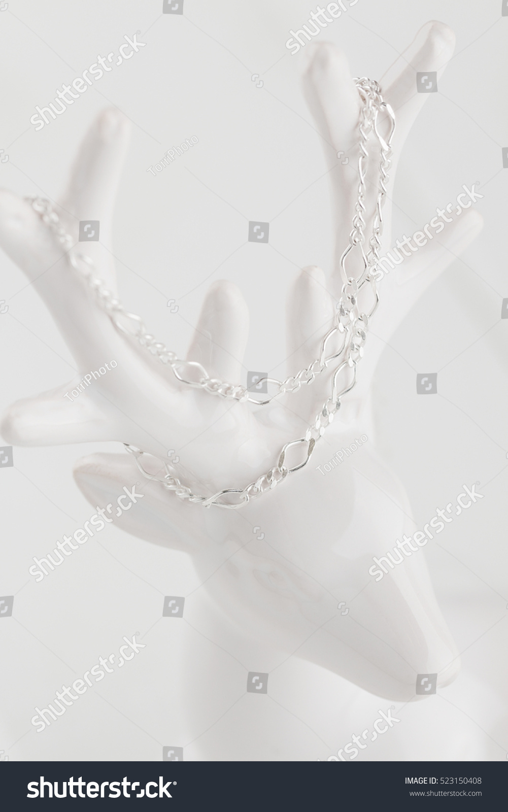https://www.shutterstock.com/pic-523150408/stock-photo-sterling-silver-chain-on-white-jewelry-holder-still-life.html