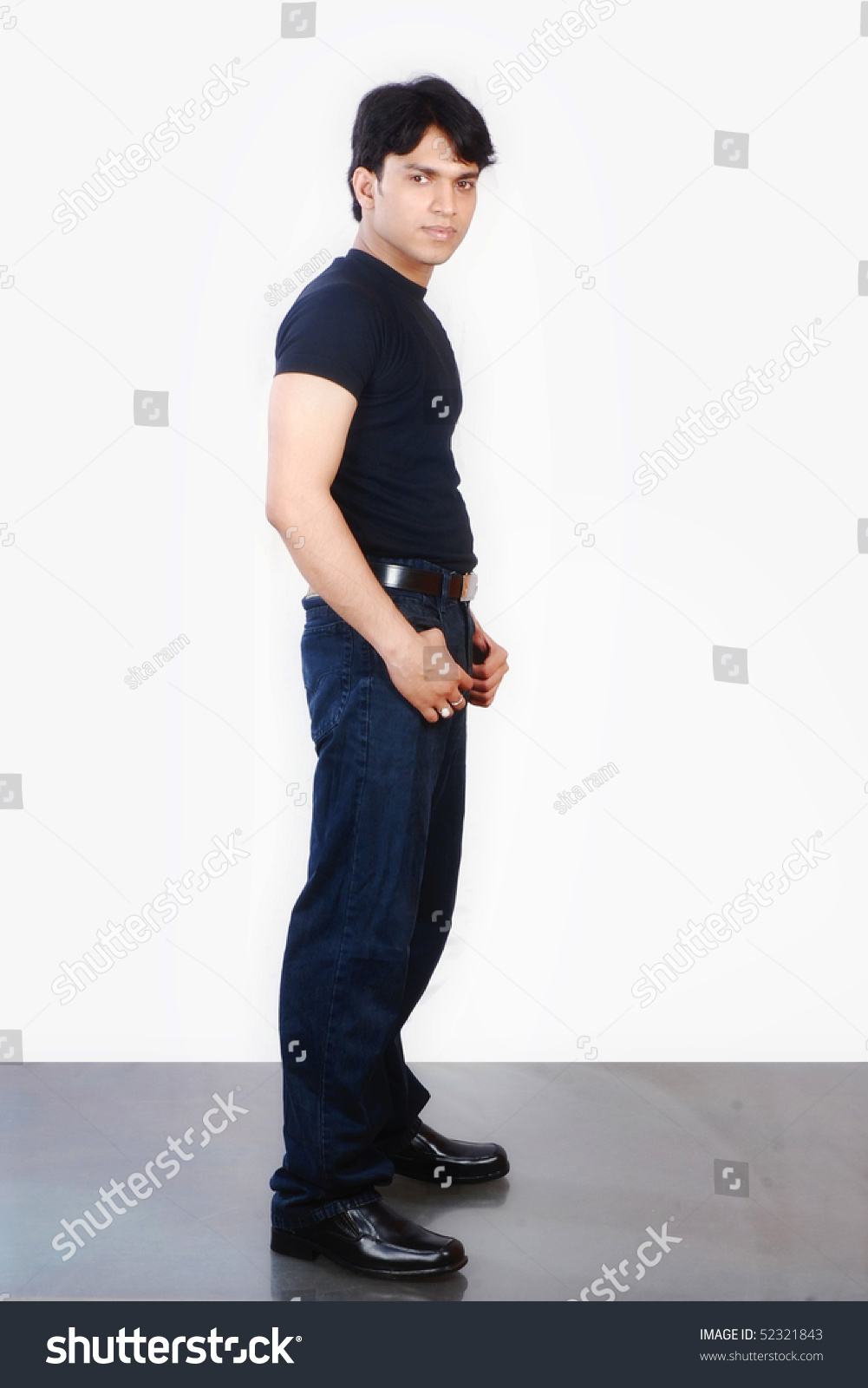 Black t shirt blue jeans - A Indian Male Boy Wearing Black T Shirt And Dark Blue Jeans Standing In Side