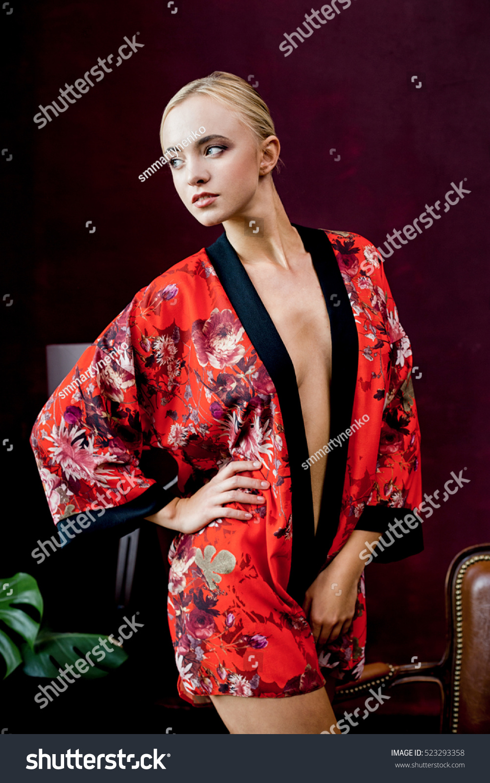 beautiful young woman in robe. beautiful young woman in robe. slim body of  the beautiful woman with blond hair. beautiful sexy blond woman with big  breast.