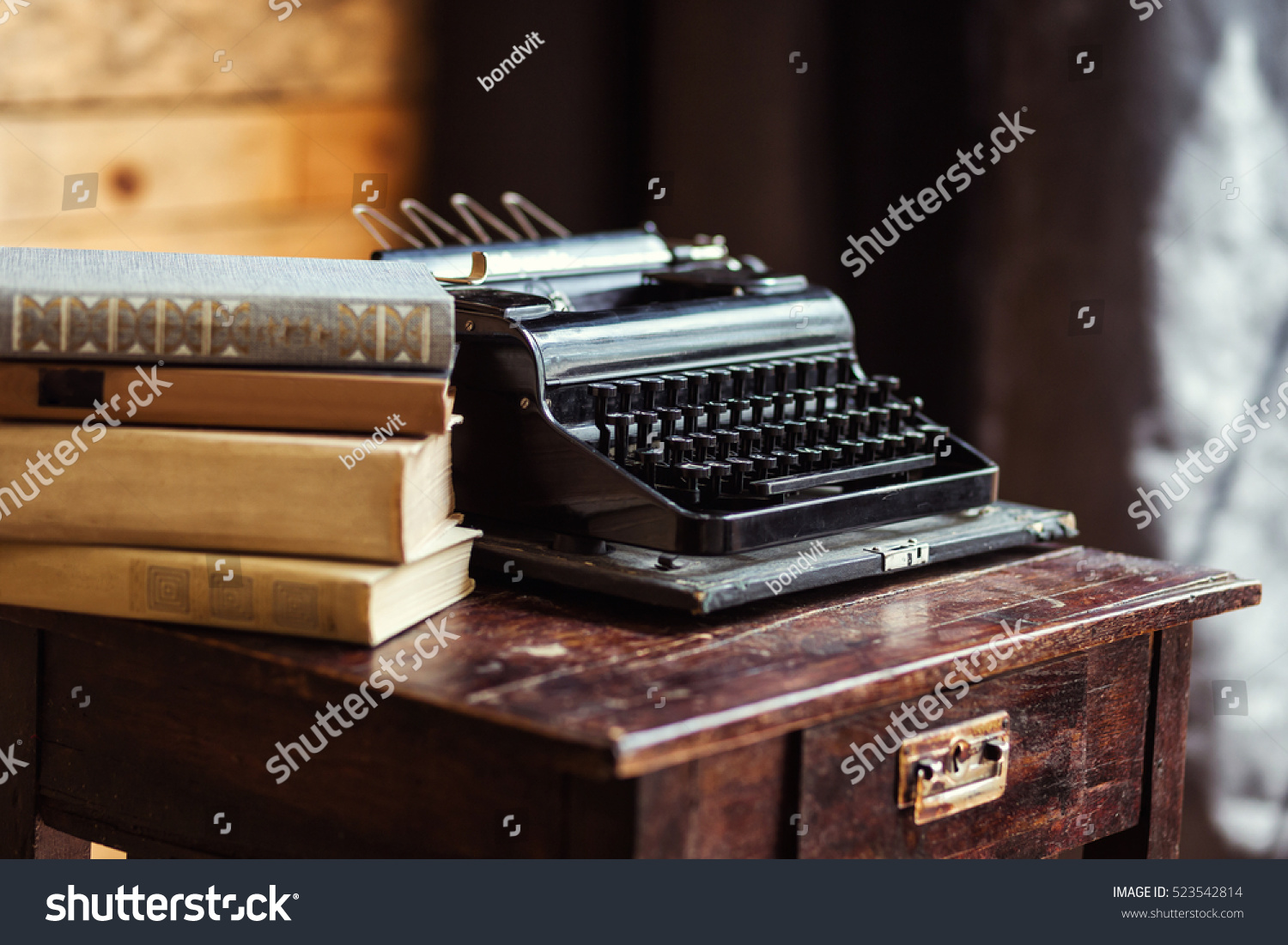 typewriter and books on the table, vintage typewriter and old books,  vintage,writer - Typewriter Books On Table Vintage Typewriter Stock Photo 523542814