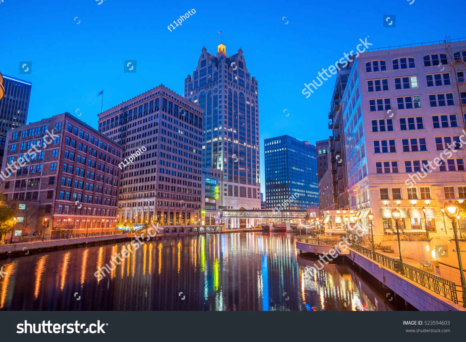 Downtown skyline with Buildings along the Milwaukee River at night in Milwaukee Wisconsin