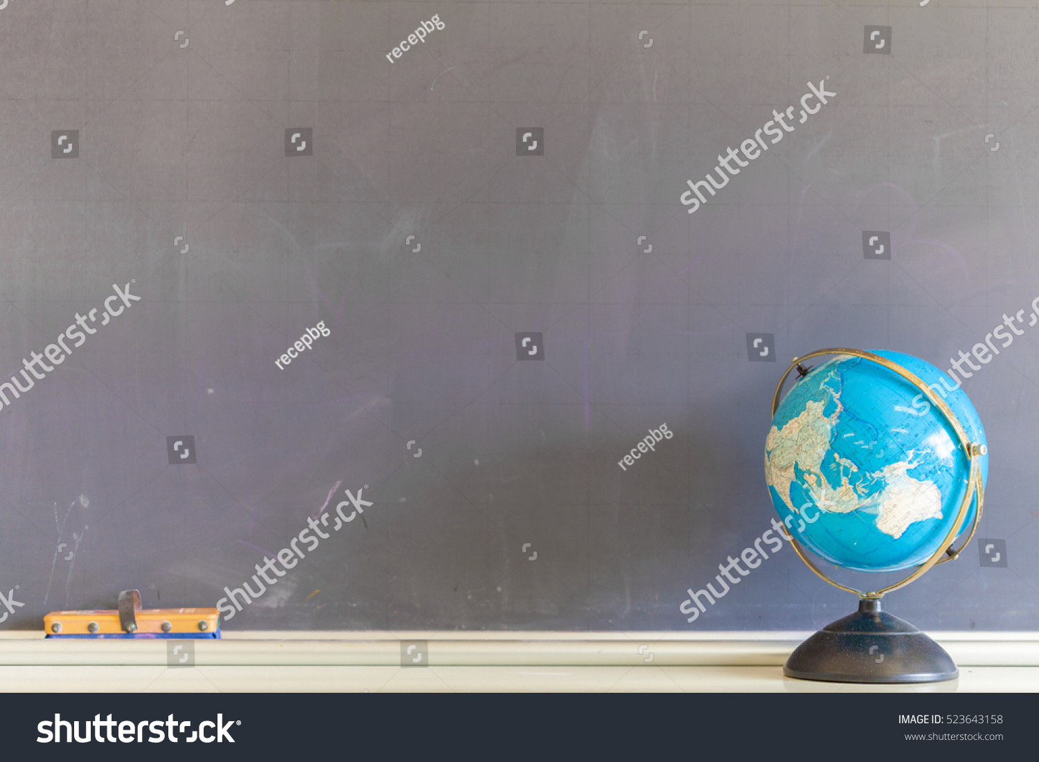 Globe and Blackboard in Classroom