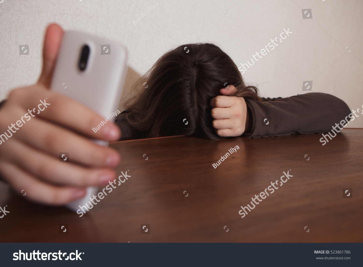 Desperate to use the bathroom - Young Sad Vulnerable Girl Using Mobile Phone Scared And Desperate Suffering Online Abuse Cyberbullying Being Stalked