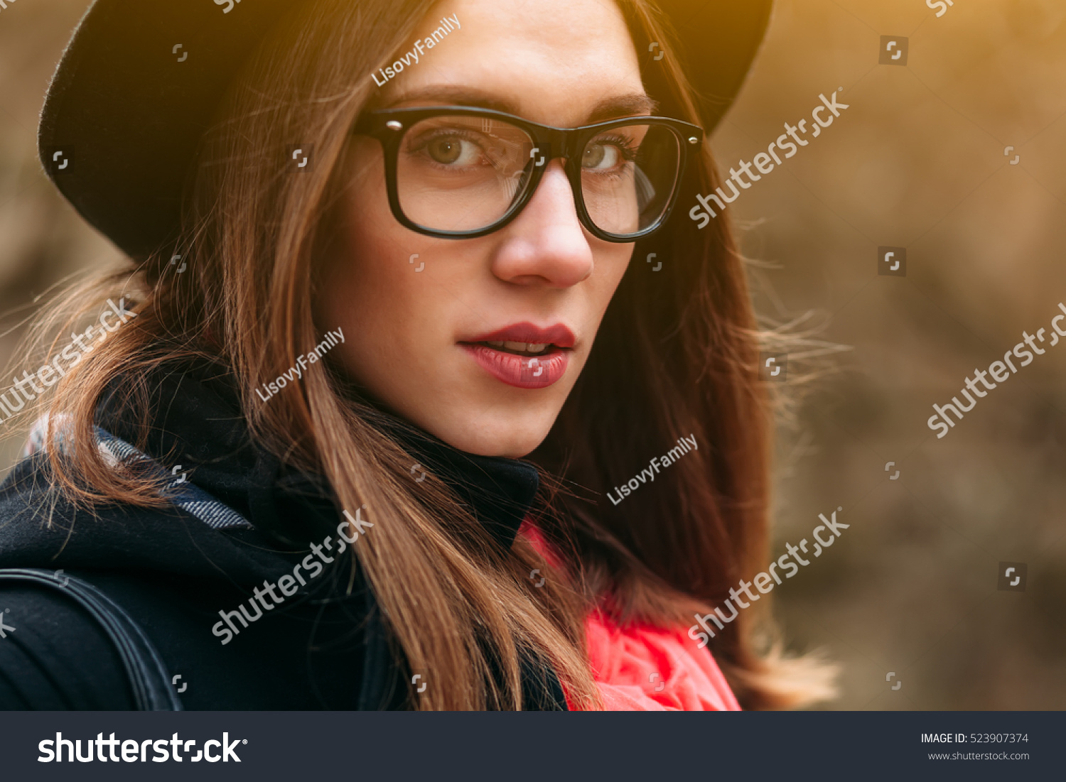 b418f5fa90d9 Close up portrait of beautiful girl in hat and glasses sitting on bench in  sunny autumn