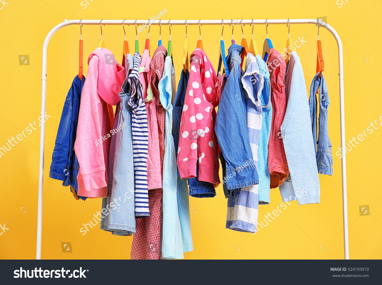 Clothes hanging on rack, closeup #524193919