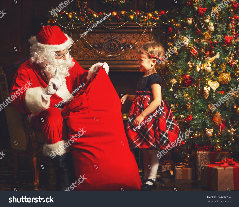 santa claus presents christmas gift happy child girl - Santa Claus Presents