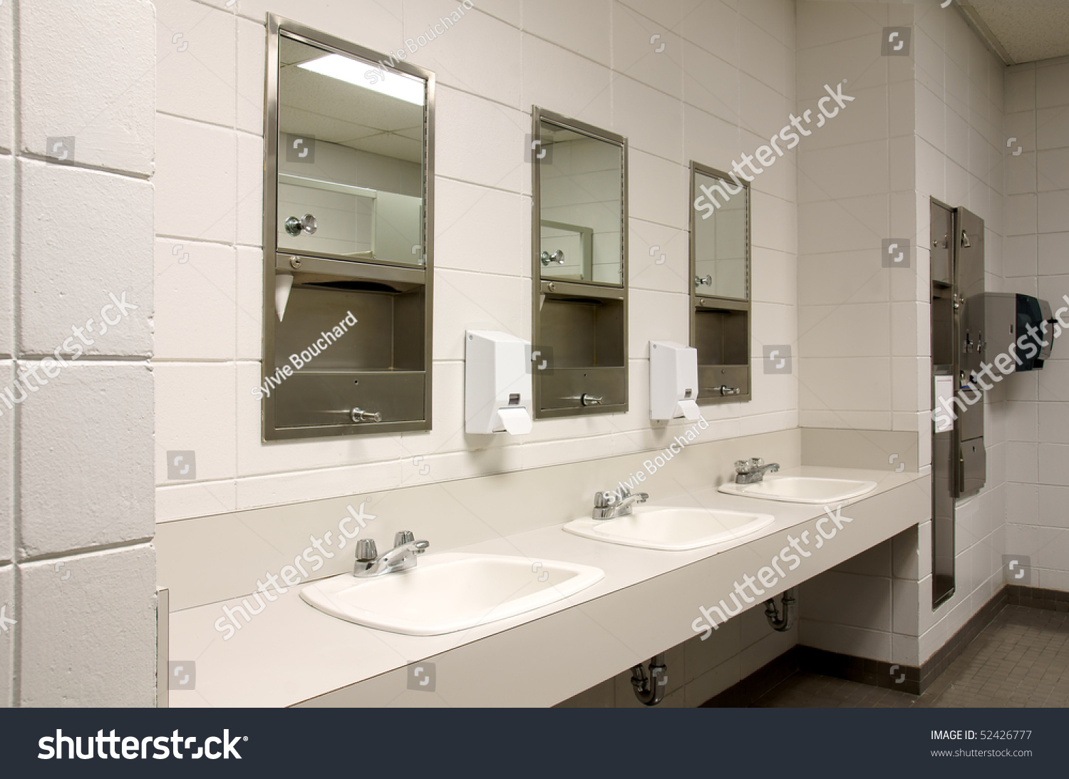 Perspective shot countertop three sinks mirors stock photo for Public bathroom sink