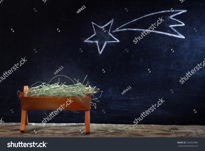 Birth jesus manger star on blackboard stock photo