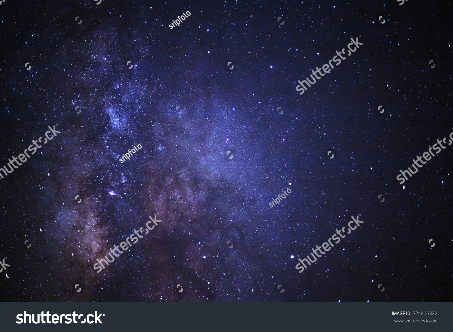 Close-up of Milky way galaxy with stars and space dust in the universe, Long exposure photograph, with grain. #524406322