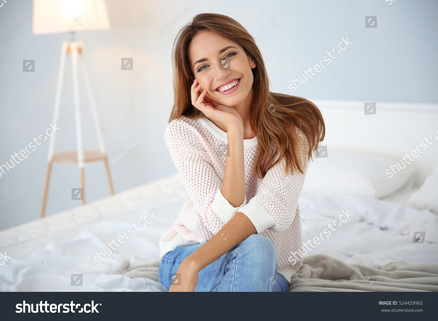 Young beautiful woman sitting on bed at home #524429965