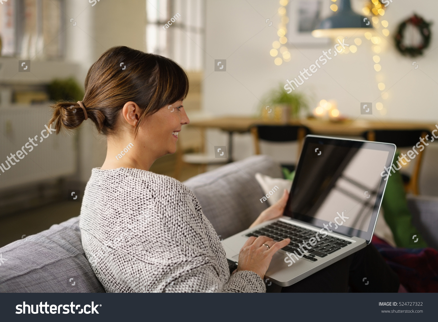 smiling woman sitting surfing internet on stock photo 524727322