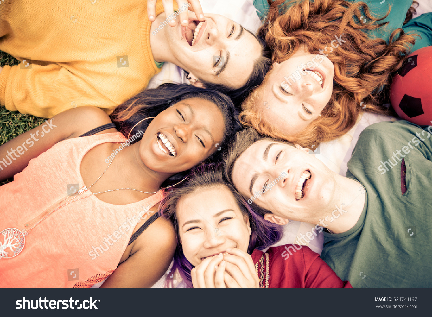 Group of  friends laughing out loud outdoor, sharing good and positive mood. #524744197