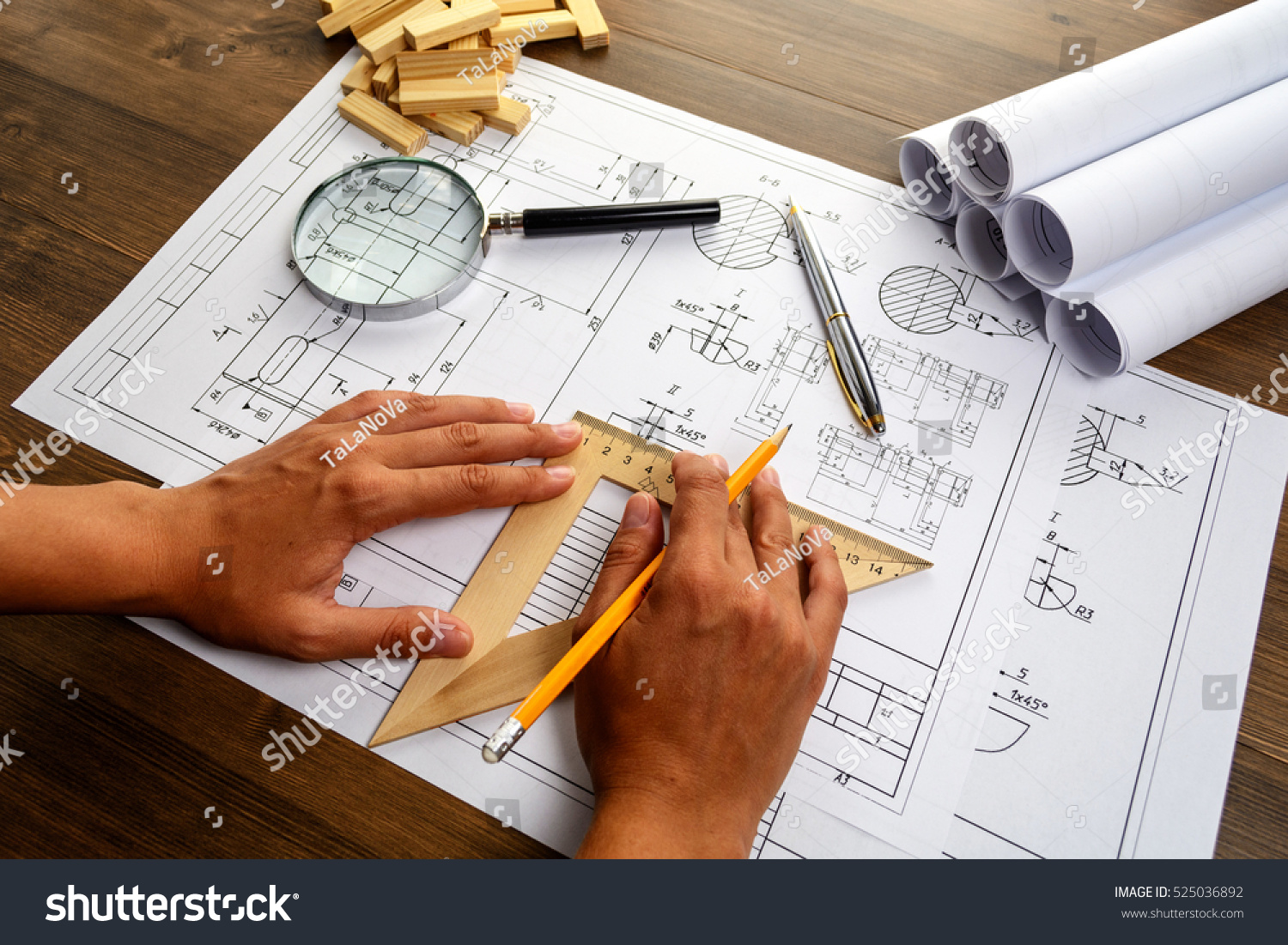Mechanical engineer at work. Technical drawings. Paper with technical drawings and diagrams. #525036892