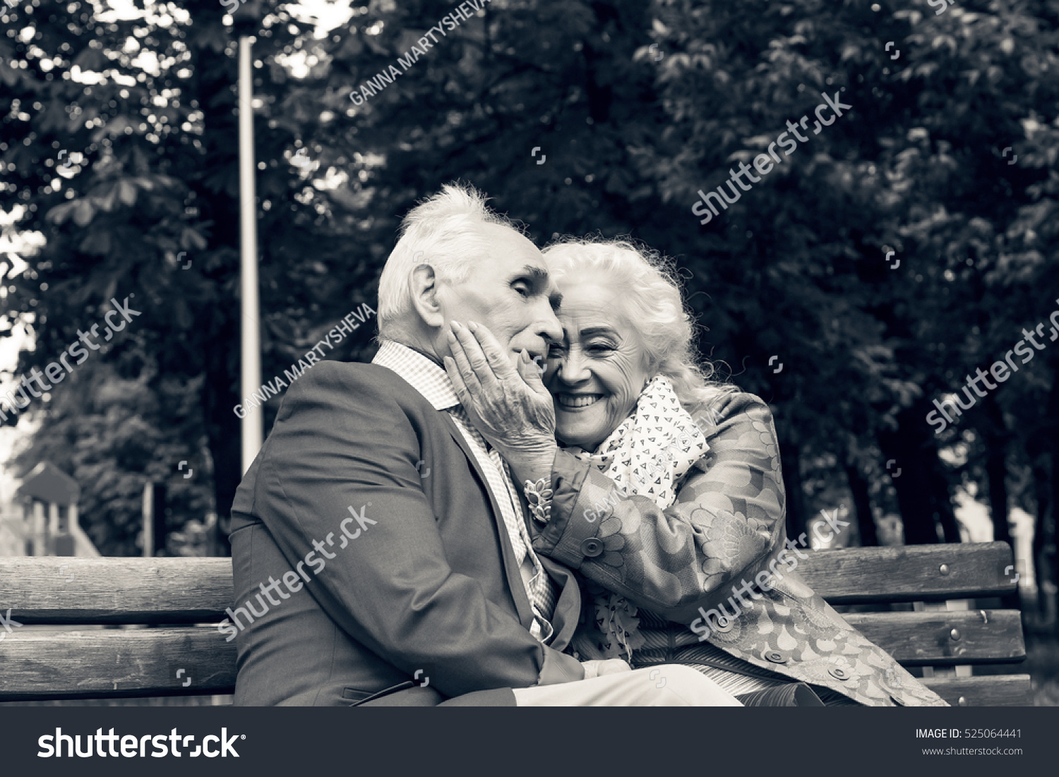 Black And White Photo Elderly Family Couple Talking On A Bench In City Park