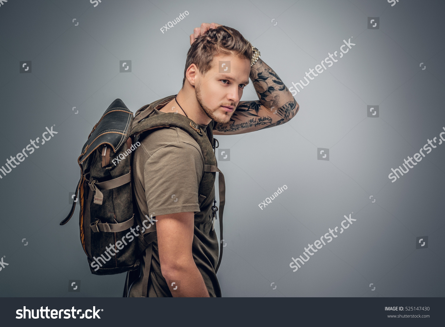 Studio portrait urban style backpackers tattoo stock photo for Urban s tattoo studio