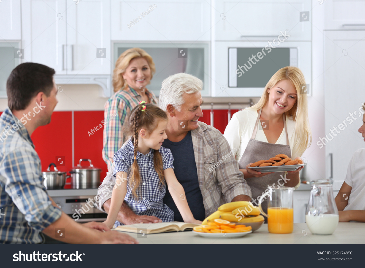 Happy large family on kitchen stock photo 525174850 for Large family kitchen