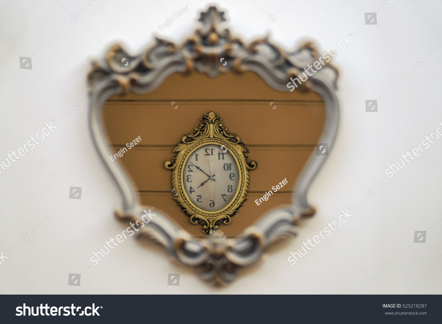 Retro style wall clock reflection inside stock photo 525218287 retro style wall clock reflection inside a mirror on a wall amipublicfo Gallery
