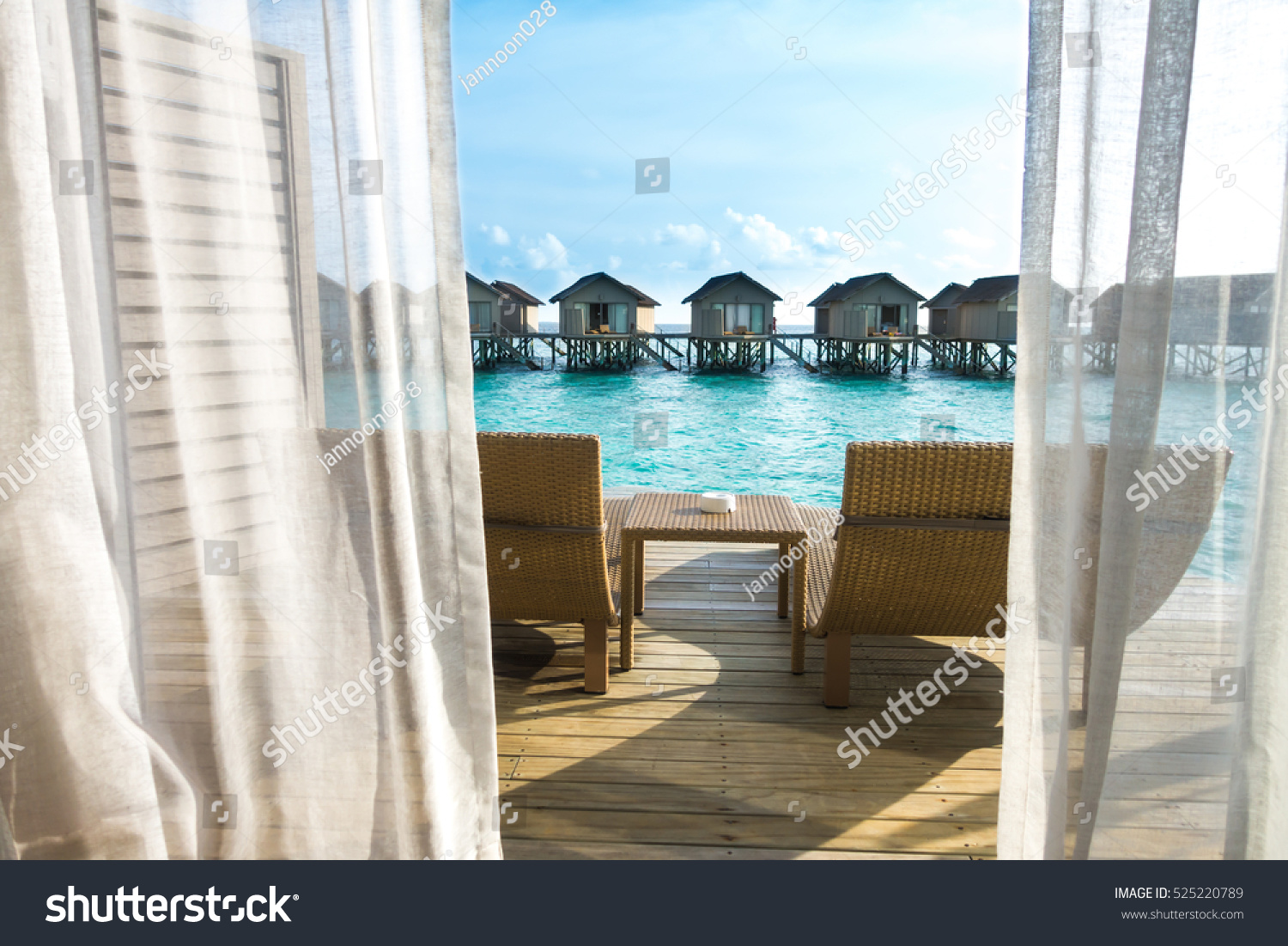 Beautiful tropical Maldives resort hotel with beach and blue water. #525220789