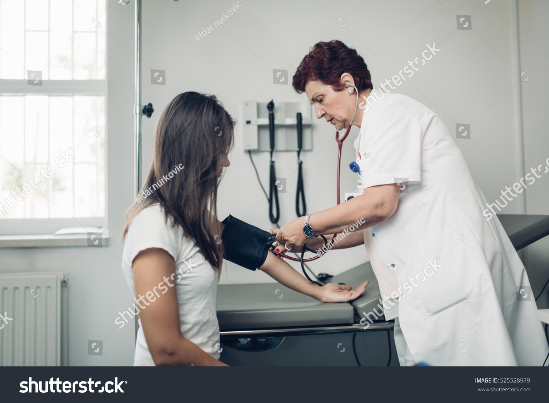 Nurse Measuring Her Patients Heart Pressure Stock Photo ...